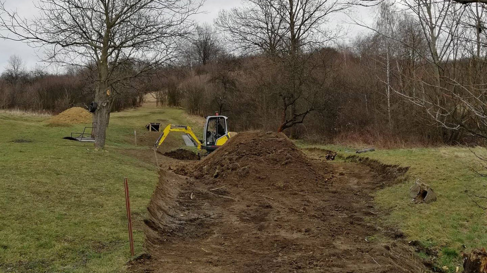 A digger working on the course